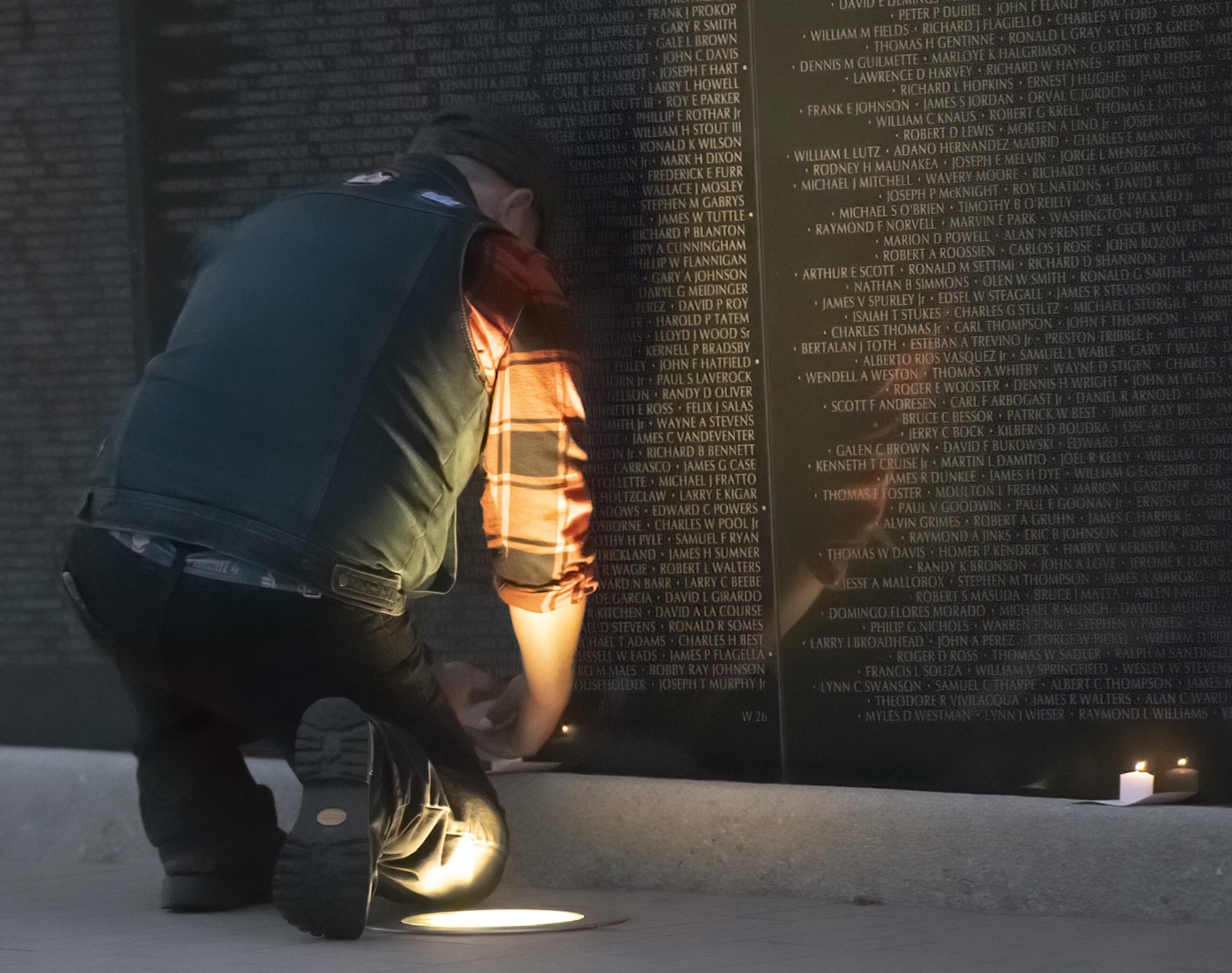 Kneeling at the Candle Light Vigil